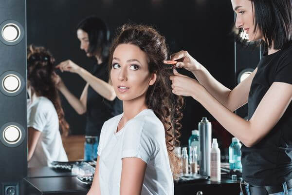 woman getting hair brushed